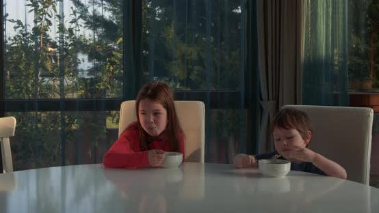 Thumbnail for Happy Children Eating Corn Flakes for Breakfast. Brother and Sister Have Corn Flakes for Breakfast