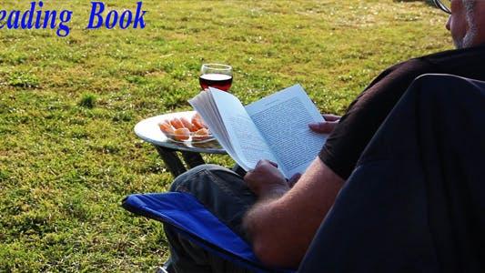 Thumbnail for Man Reading Book