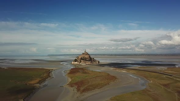 Aerial Drone View of Le Mont Saint Michel, Iconic Island and Monastery at Suny Day, Normandy, France