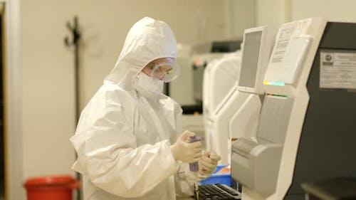 Scientist Testing Test Tube with Blood Sample to Coronavirus