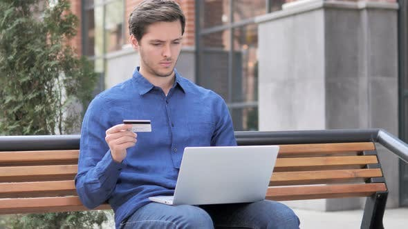 Thumbnail for Online Shopping by Young Man Sitting on Bench