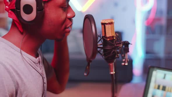 Thumbnail for Young Black Hip-Hop Singer Recording Song in Home Studio