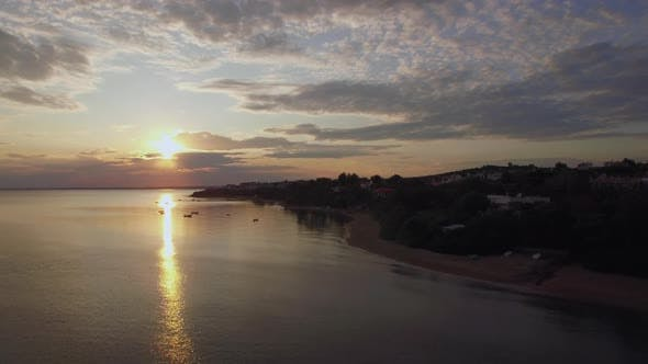 Thumbnail for Coast with Houses and Golden Sunset Over Sea, Aerial. Trikorfo Beach, Greece