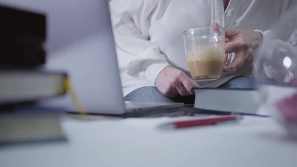 Thumbnail for Close-up of Table with Laptop and Books