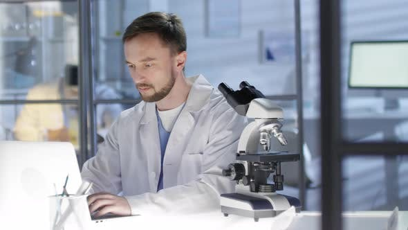 Thumbnail for Medical Researcher Working on Thesis in Lab
