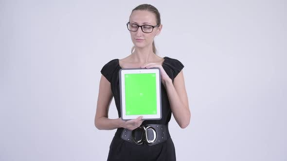 Cover Image for Happy Blonde Businesswoman Thinking While Showing Digital Tablet