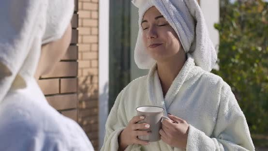 Cover Image for Portrait of Young Lady in Bathrobe and Hair Towel Standing Outdoors And, Looking at Camera and
