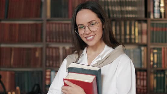 Thumbnail for Portrait of Smiling Girl in Library