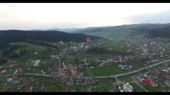 Thumbnail for Inflatable Balloon Flies Over a Small Town. Aerial View