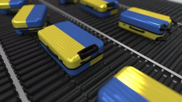Thumbnail for Suitcases with Flag of Ukraine on Roller Conveyer