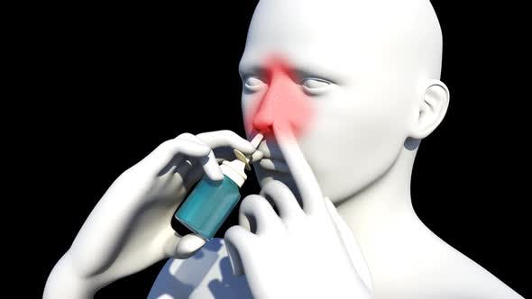 Man Using A Decongestive Nasal Spray