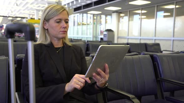 Thumbnail for Business woman using digital tablet at airport