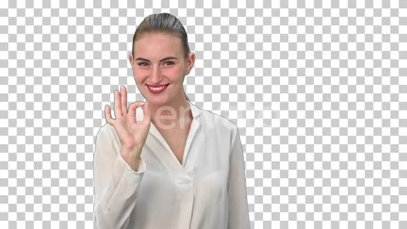 Happy young woman showing OK sign, Alpha Channel