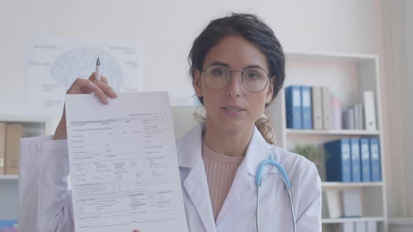 Doctor Showing Form to Online Patient