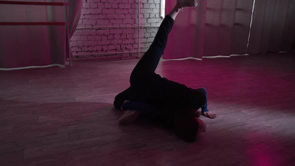 A Curly-haired Young Girl at a Dance School Dances Jazz Modern, Contemporary Dance on the Floor in