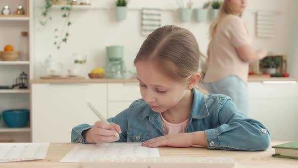 Thumbnail for Girl Is Studying Online in the Kitchen
