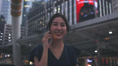 Happy Woman Walking and Talking Over Phone