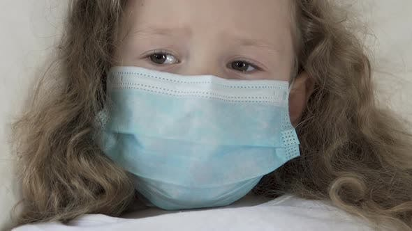 Thumbnail for Seriously Sick Female Kid in Medical Mask Looking
