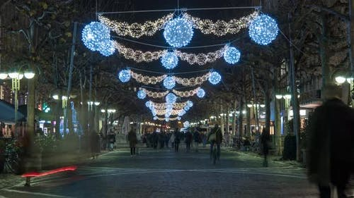 Timelapse of people walking on decorated street
