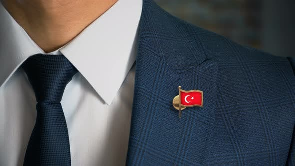 Thumbnail for Businessman Walking Towards Camera With Country Flag Pin Turkey