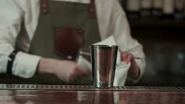 Cover Image for Barman at Work Rubs Wooden Table with Napkin