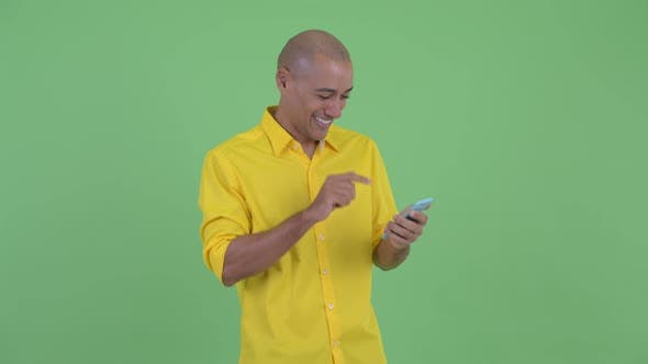 Thumbnail for Happy Handsome Bald Businessman Thinking While Using Phone