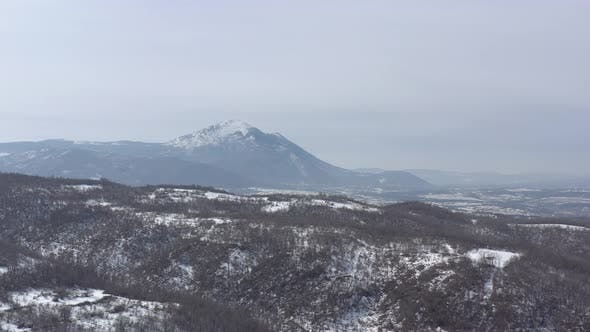 Snow over the top of  mountain Rtanj 4K aerial video