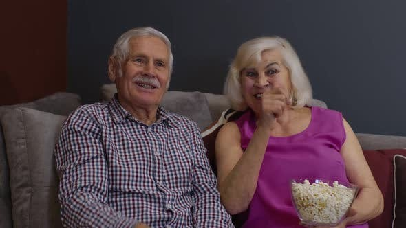 Overjoyed Old Mature Couple Football Fans Watching Sport Tv Game Support Cheer Winning Soccer Team