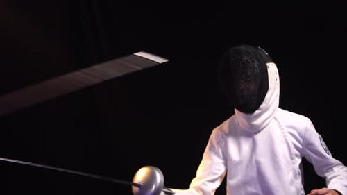 A Young Guy Fights a Duel Participating in a Fencing Tournament
