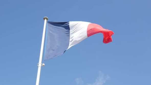 Thumbnail for Slow motion French flag in front of blue sky slow waving on wind 1080p FullHD footage - Three color