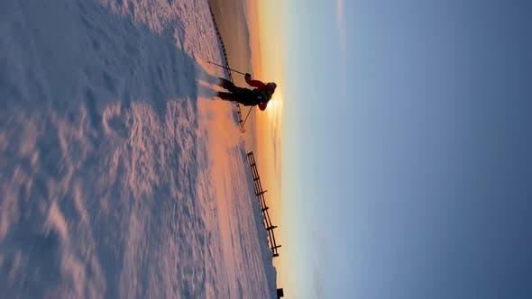 Sportsman Skies Down Along Snowy Mountain Slope in Morning