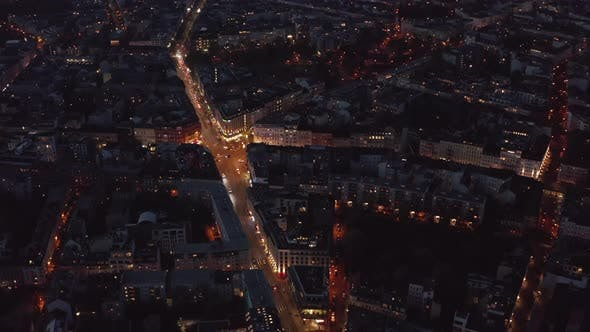 Thumbnail for AERIAL: Birds View Over Berlin, Germany Neighborhood at Night with Glowing Street Traffic City