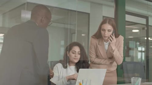 Three Colleagues Having Meeting
