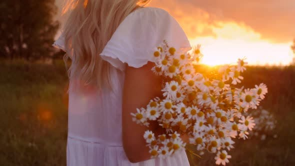 Thumbnail for Girl With Flowers at Sunset