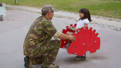 Girl Enjoying Time with Military Daddy