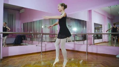 Ballerina. Girl dancer in ballet school learns to dance. Slow motion