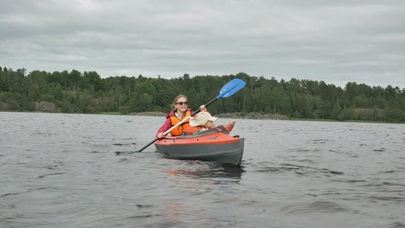 Thumbnail for Mother Rows Kayak with Little Kid Against Forest and Sky