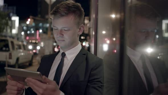 Thumbnail for Young Businessman Using Digital Tablet Computer