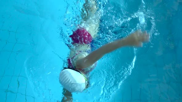 Thumbnail for Swim Finish. Slow Motion of Young Woman Swimmer Practicing Freestyle in Swimming Pool. Woman