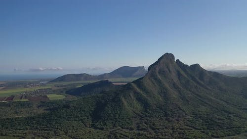 Bird's Eye View of Mountain Peaks and Green Jungles of Mauritius Africa