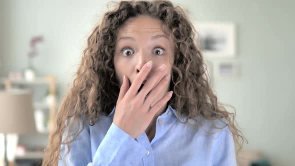 Amazed Curly Hair Woman Surprised by Positive Events