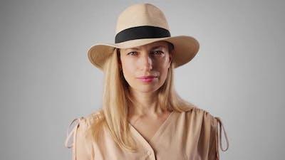 Portrait of Blonde in Hat