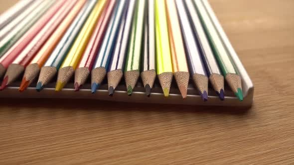 Thumbnail for Color Pencils Turning on a Brown Background