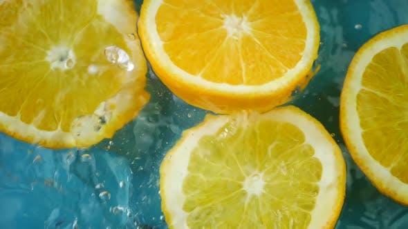 Cover Image for Juicy Orange Fruit Splashing Into Water