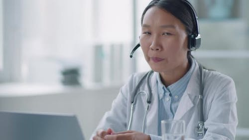 Woman Practicing Telemedicine At Work