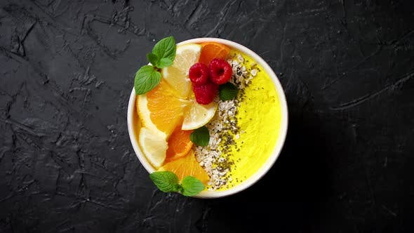 Thumbnail for Tasty Orange Fresh Smoothie or Yogurt Served in Bowl. With Raspberries, Orange Slices, Chia Seeds
