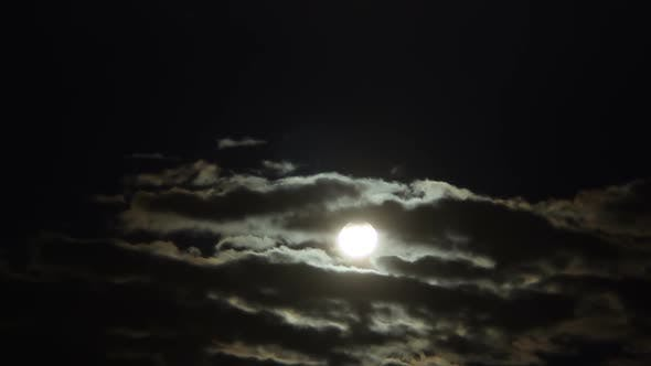 Thick Cumulus Clouds Hiding Full Moon at Midnight, Mysterious Sky, Astronomy