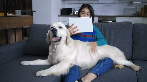 Thumbnail for Young Hindu Woman Watching Tablet and Stroking Dog