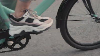 Unrecognizable Legs Riding Bike Outdoors