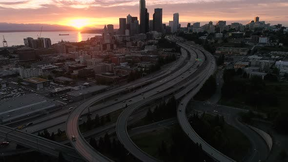 Cover Image for Amazing Sunset Aerial Of Seattle Washington With Vibrant Orange Glow On Skyscraper Buildings